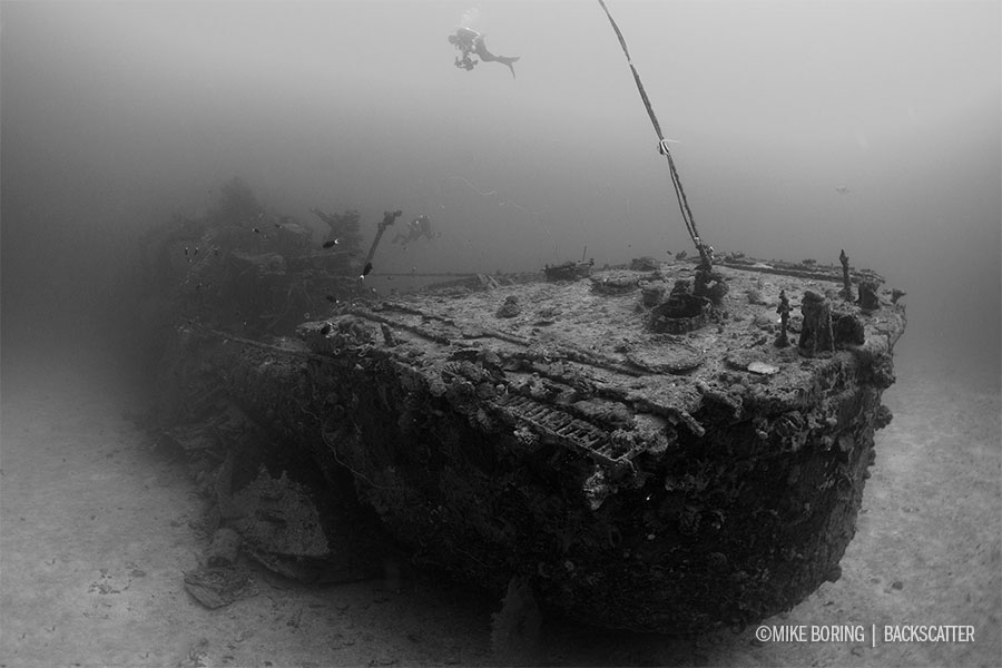 ©Mike Boring - Truk Lagoon - Becca on Wreck shooting with the Nauticam WACP Lens Port