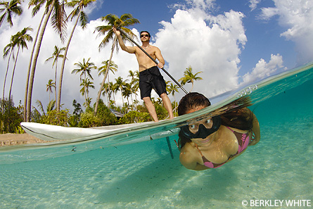 Split image of paddle boarding and snorkeler wakatobi